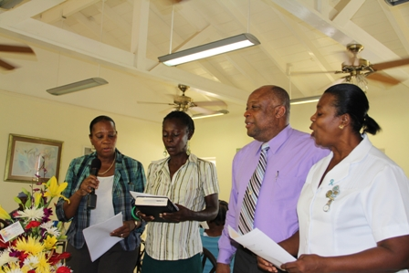 (L-R) Director of the Senior Citizens Division Mrs Garcia Hendrickson, Officer in the Division Ms, Angela Challenger, Minister of in the Ministry of Social Development Hon. Hensley Daniel and Assistant Nurse Manager at the Flamboyant Nursing Home Ima Stanley singing a hymn during the birthday celebration of Mrs. Lucina Brown at the Flamboyant Nursing Home