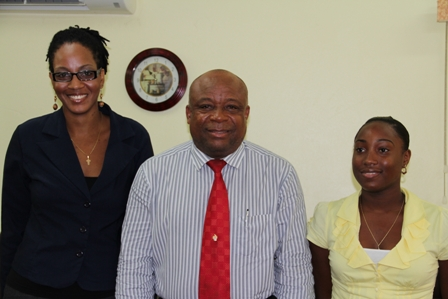 Minister of Youth and Health in the Nevis Island Administration Hon. Hensley Daniel at the ceremony to announce the winners of the Nevis Island Administration/Medical University of the Americas Health Science Scholarships (middle) flanked by Ms. Kamara Louisy (l) and Ms. Earline Pemberton (r)