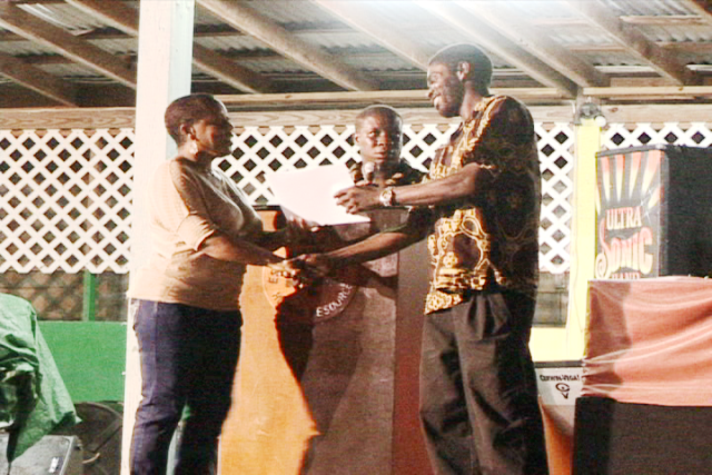 "Calvin ""Isoursop"" Johnson presents cheque to the Nevis Renal Society on behalf of the Isoursop Making a Difference Foundation."