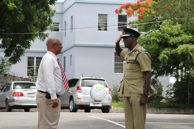 Newly sworn-in Commissioner of Police for the Royal St. Christopher and Nevis Police Force, Mr. Celwyn Walwyn, salutes Premier of Nevis the Honourable Joseph Parry.