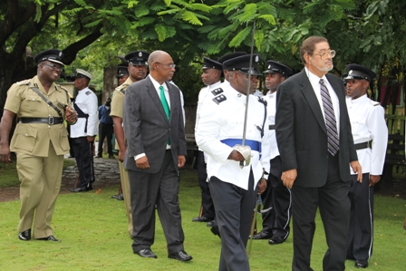 Deputy Governor General His Honour Eustace John inspects the Guard of Honour accompanied by Premier of Nevis Hon. Joseph Parry (second row left) and Commander of the Nevis Police Division Superintendent Hilroy Brandy (extreme left) at the grounds of the Nevis Island Assembly, moments before he delivered the Throne Speech