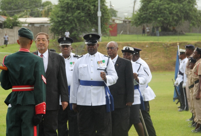 Deputy Governor General His Honour Eustace John and Premier of Nevis the Honourable Joseph Parry inspect armed and unarmed bodies during St. Christopher and Nevis' 28th anniversary Independence parade and awards ceremony