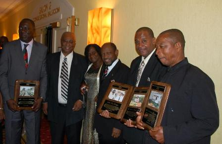 Premier of Nevis, Hon. Joseph Parry with Awardees-L to R- Mr. Augustine Merchant, Premier Parry, Mrs. Emontine Thompson, Prime Minister Dr. Denzil Douglas, Mr. Eric Evelyn and Mr. William Thompson (husband of Emontine Thompson)