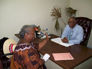 Premier of Nevis, Hon. Joseph Parry and a visitor to his one on one Wednesday sessions.