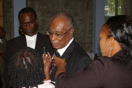 Premier of Nevis, Hon. Joseph Parry and his lawyer, Mr. Oral Martin talking to reporters.