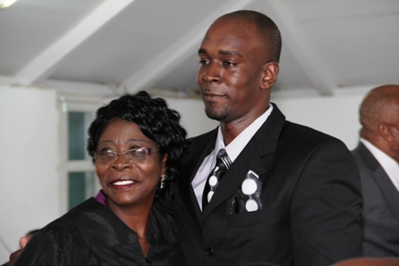 New President of the Nevis Island Assembly warmly congratulated by her son Shawn after he witnessed her being sworn in as the third President of the House