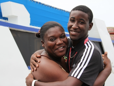 Adrian Williams embraces the official chaperon of his Gladiators Track Club Ms. Rovina Jeffers