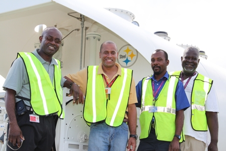(L-R) General Manager of the Nevis Air and Seaports Authority Mr. Spencer Hanley, General Manager of the Airport at Newcastle Mr. Steven Henley, Re-fueller at the Airport Mr. Trevor Powell and Head of Security at the Nevis Air and Seaports Authority Mr. Elroy Hendrickson with the newly installed AV-Gas tank in the background
