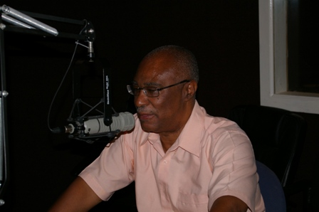Premier of Nevis, Hon. Joseph Parry on the radio