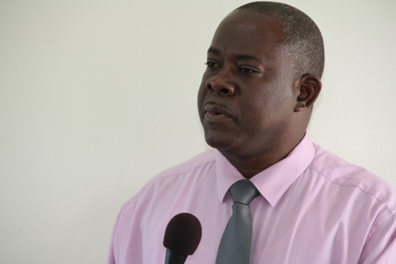 Minister of Cooperatives in the Nevis Island Administration Hon. Robelto Hector speaking at the launch of the New River Farmers Development Cooperative Society Limited, at the Department of Agriculture's conference room in Prospect