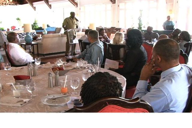 Commissioner of Police Celvin G. Walwyn addresses business personnel at third quarterly luncheon of the Nevis Division of the St. Kitts-Nevis Chamber of Industry and Commerce