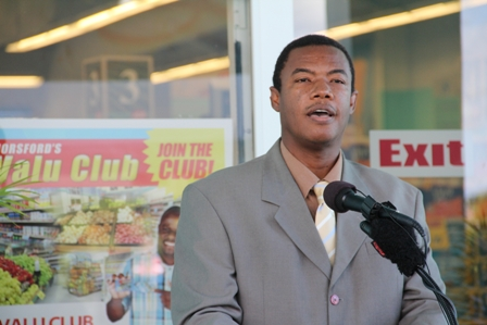 Minister responsible for Trade and Industry and Consumer Affairs on Nevis Hon. Dwight Cozier delivering remarks at the dedication of Horsford's Valu Mart IGA Supermarket and Commercial Complex at Farms Estate in Nevis