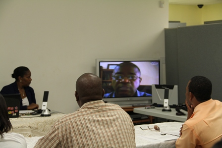 Chief Medical Officer in St. Kitts and Nevis Dr. Patrick Martin speaking to participants at an Integrated Vector Management Workshop sponsored by PAHO via Skype at the Llewelyn Newton Disaster Management Conference Room at lontg point in Nevis. (Up front) Medical Officer of Health on Nevis Dr. Judy Nisbett looks on