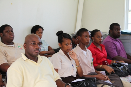 (L-R) Hydroponics Farmer on Nevis Mr. Marcel Hanley sits with students and Teacher from the Gingerland Secondary School and other participants at the Hydroponics Nutrients Workshop in Prospect
