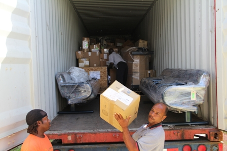 Alexandra Hospital Maintainance staff unloading the container filled with medical supplies, equipment and furniture from Global Links