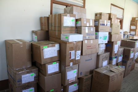 Some of the unloaded medical supplies for the Alexandra Hospital in storage
