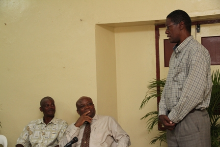 Basic Plumbing Installation Course participant Mr. Keithley Amory delivering the Vote of Thanks while (L-R) Course Tutor Mr. Alex Claxton and Social Development Minister Hon. Hensley Daniel listen attentively