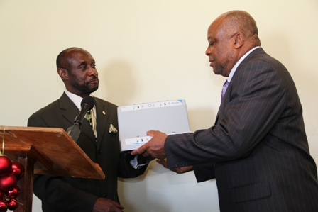 (L-R) Deputy Prime Minister and Federal Minister responsible for Social Security Hon. Sam Condor hands over medical equipment to Deputy Premier of Nevis and Minister of Health in the Nevis Island Administration Hon Hensley Daniel at the Alexandra Hospital's conference room