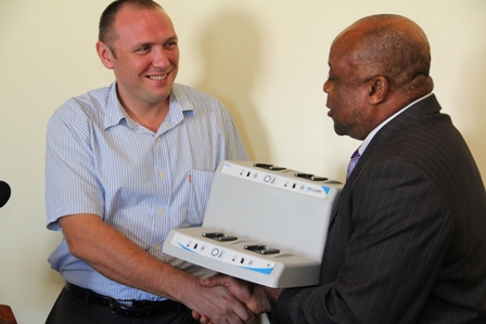 (L-R) Surgeon at the Alexandra Hospital Dr. Oleksandr Rakovets receives equipment from Minister of Health and Deputy Premier Hon. Hensley Daniel