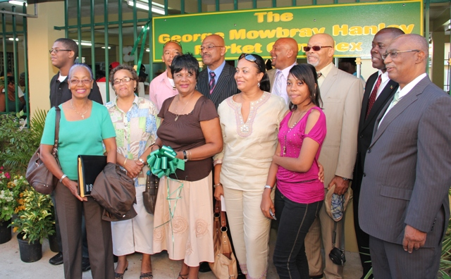 Premier of Nevis the Honourable Joseph Parry and Agriculture Minister the Honourable E. Robelto Hector share proud moment with members of the Hanley family