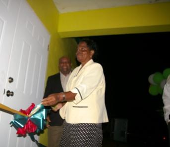Miss Soretha France cutting the ribbon with Deputy Premier, Hon. Hensley Daniel looking on