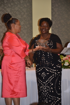 Mrs. Suzette Sampson of the Violet O. Jeffers Nicholls Primary School receives plaque from Mrs. Sonita Daniel wife of Deputy Premier Hon. Hensley Daniel