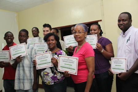 Participants of the Ministry of Social Development's Basic Plumbing Installation Course showing off their Certificates of Achievement after successful completion