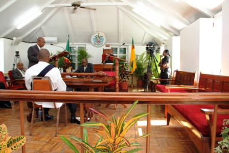 Premier of Nevis and Minister of Finance, Hon. Joseph Parry in the House of Assembly among empty Opposition benches.