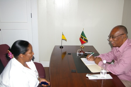 Premier of Nevis, Hon. Joseph Parry speaking to Mrs. Modesta Tyson at a One-on-One meeting.