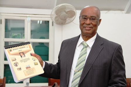 Premier of Nevis, Hon. Joseph Parry holding 2012 Budget Address Booklet