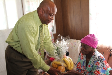 A heart warming moment between Birthday Girl Ms. Eulalie Brown and Minister of Social Development responsible for the care and wellbeing of senior citizens on Nevis during a special visit for her birthday