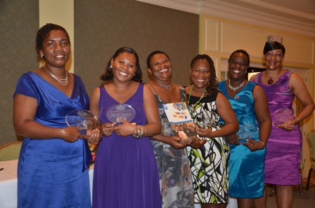 Reading Recovery Specialist Mrs. Palsy Wilkin (third from left) with teachers honoured for their work in Reading Recovery (L-R) Mrs. Omelle Browne, Mrs. Julie Pemberton, Ms. Leona Freeman, Mrs. Terres Dore and Mrs. Judy Parris-Rawlins