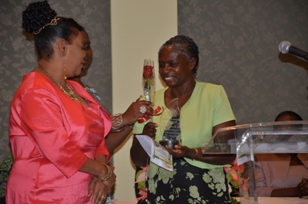 Recent Retiree Mrs. Gurtis Brown receives her award