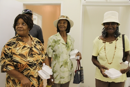 Seniors enjoying what they see in the kitchen area of the new Cotton Ground Community Centre