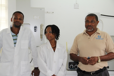 (L-R) Senior Lab Technician at the Nevis Water Department's Laboratory Mr. Llewellyn Wiltshire, Analyst Mrs. Marsha Smith and General Manager Mr. George Morris at the Water Department's lab facility in Stoneygrove
