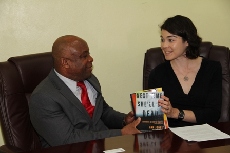 (R) Deputy Public Affairs Officer at the Embassy of the United States to Barbados and the Eastern Caribbean Ms. Rachel Zaspel hands over collection of books to Minister for Social Development on Nevis Hon. Hensley Daniel