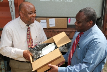 Minister of Health in the Nevis Island Administration Hon. Hensley Daniel hands over the container load of medical supplies from the Hospital Sisters Mission Outreach to Medical Chief of Staff at the Alexandra Hospital Dr. John Essien
