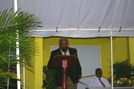 Minister for Social Development on Nevis Hon. Hensley Daniel at the official opening ceremony of the Fountain Community Centre with Minister of Trade and Fountain Villager Hon. Dwight Cozier looking on in the background.