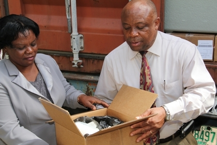 Director of the Development Projects Foundation Incorporated on Nevis Mrs. Myrthlyn Parry hands over 40foot container load of medical supplies and equipment to Minister of Health in the Nevis Island Administration Hon. Hensley Daniel at the Alexandra Hospital