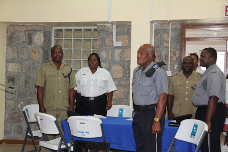 More Police Officers stationed in the Royal St. Christopher and Nevis Police Force Nevis Division singing the National Anthem at the start of the Programme