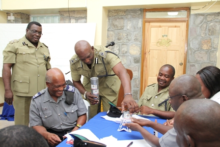 "Assistant Commissioner of Police (ACP) in the Royal St. Christopher and Nevis Police Force with responsibility for the Nevis Division Mr. Robert Liburd and Divisional Officer Superintendent Hilroy Brandy join ranks at the Nevis Division during an interactive session on ""Effective Team Leadership Strategies"" presented by Mr. Noah G. Mills of SEN Consulting. They were at the Division's annual New Year's Programme at the Charlestown Police Station's Recreational Centre on January 4, 2011"
