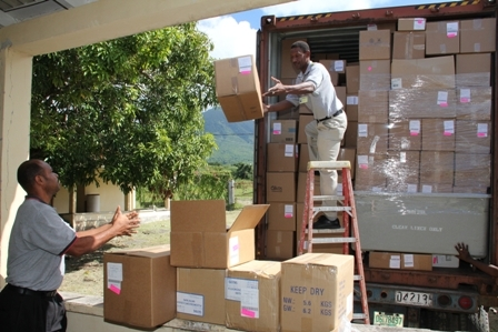 The 40ft container load of medical supplies and equipment being offloaded by Maintenance Staff of the Alexandra Hospital