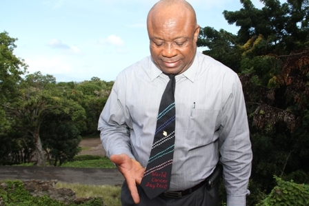 Deputy Premier and Minister of Health on Nevis Hon. Hensley Daniel wearing one of the five neck ties donated to the Nevis Island Cabinet by the St. Pauls Anglican Church in observance of World Cancer Day on February 4th