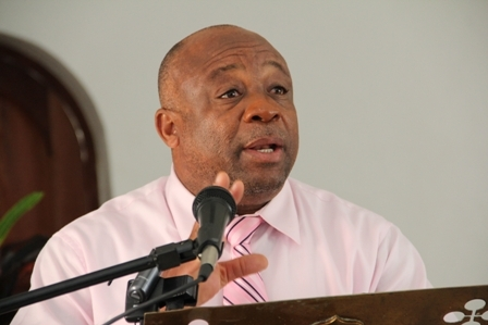 Minister of Health in the Nevis Island Administration Hon. Hensley Daniel delivering remarks at the Oncology Symposium hosted by the Ministry of Health in conjunction with Pink Lily Cancer Care at the St. Pauls Anglican Church Hall on Wednesday February 8th, 1012