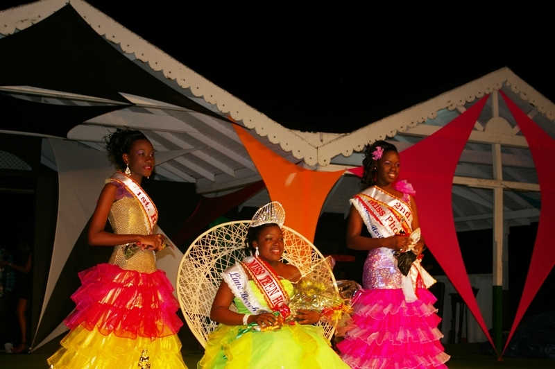 Former Miss Teen Hospitality 2011, Miss Erica Doras adjusting the crown after it was placed by Premier of Nevis, Hon. Joseph Parry on Miss Kevonie Pemberton, Miss Teen Hospitality 2012