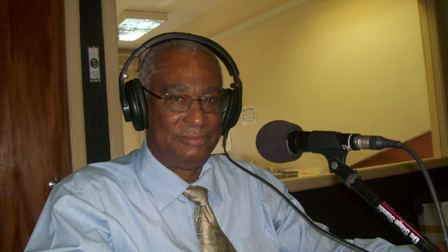 Premier of Nevis, Hon. Joseph Parry on the radio (file photo)