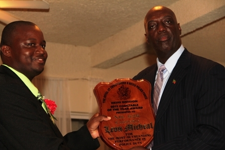 (L-R) Royal St. Christopher and Nevis Police Force Commissioner Mr. Celvin G. Walwyn present Constable of the Year Leon Michael with his award