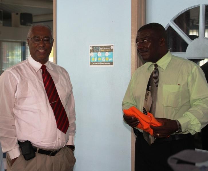 Premier, Hon. Joseph Parry and Charlestown Secondary School Headmaster, Mr. Edson Elliott