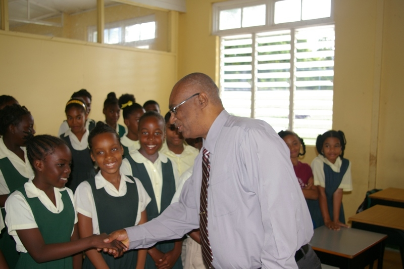 Premier of Nevis , the Hon.Joseph Parry greeting school children at Ivor Walters