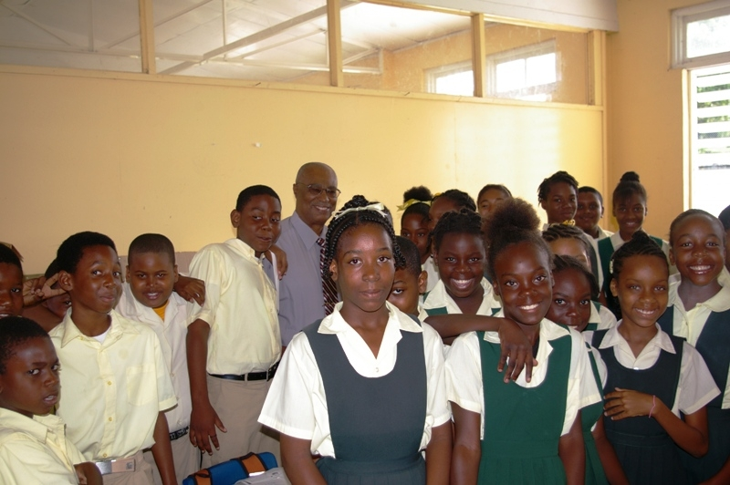 Premier, Hon. Joseph Parry with children of the Ivor Walters Primary School children